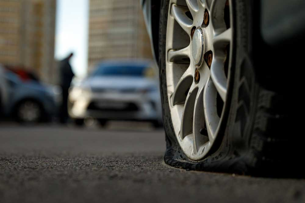 Flat tire in need of auto repair
